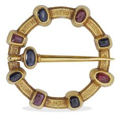 This medieval gold brooch, set with rubies and sapphires, was a lover's gift. The back of the brooch carries an inscription in Old French for the benefit of the wearer: 'Io sui ici en lui dami: Amo' (translation: I am here in place of the friend I love).