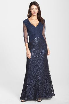 TADASHI SHOJI SEQUIN LACE GOWN  Pintuck pleating adds to the elegance of a dreamy V-neck gown that flows into a floor-skimming skirt sparkling with sequined lace. Sheer three-quarter sleeves heighten the romance of this style, while a crisscrossing woven-style bodice slims the silhouette.