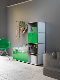 A USM Haller garderobe in green for your shoes and belongings. #furniture…