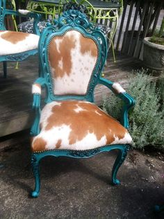 Something Old made Something New. It's something Blue. As for the borrowed... Your Friends will Want one TOO! I reupholstered and painted 4 of these chairs for a client who put them in her eat -in-kitchen on top of a cowhide rug!