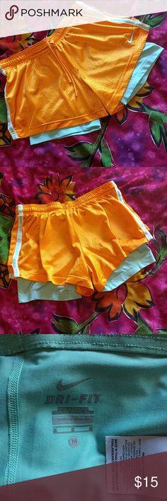 Nike dri-fit athletic shorts size M Dri-fit short in bright orange and pastel green. No damage. Nike Shorts