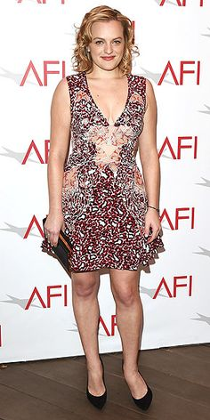 ELISABETH MOSS Kiernan's Mad Men costar seems to have gotten the mixed-print memo too, opting for a Tanya Taylor leopard-and-lace number with a cutout center, then adding simple accessories for her AFI Awards look.