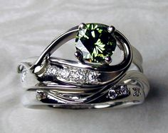 Green diamond engagement ring set. Free-form engagement ring with matching  fitted band. Green diamond set in 4-prong…