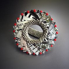 Folded recycled paper & beaded ring.
