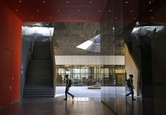 A student walks toward a staircase in the unifying central courtyard of the McMurt ry Building at Stanford's Arts District. Photo: Paul Chinn, The Chronicle