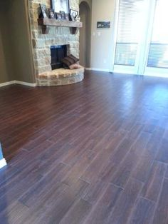 Tile that looks like wood!! Style Selections 6-in x 24-in Serso Black Walnut Glazed Porcelain Floor