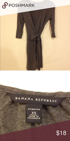 BANANA REPUBLIC GREY WRAP DRESS DARK GREY BANANA REPUBLIC DRESS, WRAPS AROUND TIES IN FRONT, COMFY STRETCH FABRIC, 3/4 SLEEVE LENGTH, WEAR CASUAL OR DRESS IT UP! Banana Republic Dresses Long Sleeve