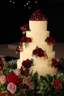 The beautifully fragrant white chocolate cake, decorated with fresh roses, rose hips and orchids.
