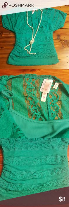 """Teal lace top Very figure flattering,  fits more like XS, built-in matching teal cami. Dress it up or down.  Waist 25"""" Length 23"""" Three Hearts Tops Blouses"""