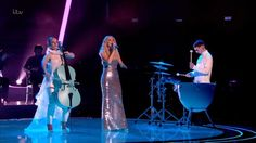 """British electronic music band Clean Bandit and Swedish singer-songwriter Zara Larsson performed live a new song """"Symphony"""" on The Voice UK."""