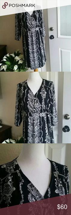 Lane Bryant dress It's black and white printed adjustable dress. Stretchy material.  36 inch long . Lane Bryant Dresses Midi