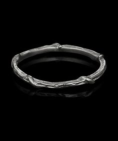 "SINGLE VINE  The ""Single Vine"" band is an even more delicate version of our ""Double Vine"" band. Wear it as a wedding ring, or stack it with several other rings for a dramatic personal statement. Shown in hand-textured 18 kt blackened white gold.  This style is also available in 18 kt yellow, rose gold, natural white gold and platinum."
