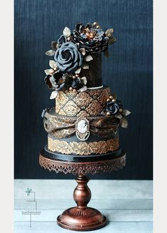 Victorian Gothic black wedding cake with gold and bronze detail~ we ❤ this! moncheribridals.com