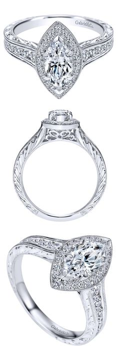 A Marquise center stone ring in this 14k White Gold Victorian Halo Engagement Ring.