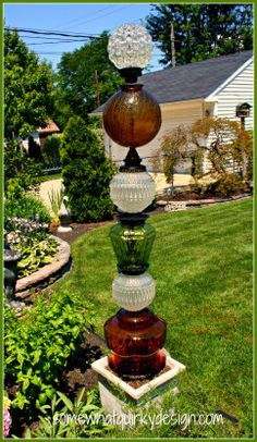 Garden art- Use old glass globes on top of a glass lamp base. You'd need to use a metal rod, which is fairly cheap and drill a hole in the bottom of the globe with a glass drill bit. Then stack and use a glass bead glue for extra stability and to keep moisture out.