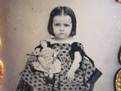 little girl holding her favorite porcelain doll ambrotype photograph