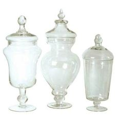 Planned on doing a candy bar for favors with apothecary jars like these stuffed with Halloween candies and chocolates.