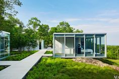 Shown: Manhattan-based couple Bob Greenberg and Corvova Lee enlisted architect Toshiko Mori to design their minimalist weekend retreat in New York's Hudson Valley. Her plan comprises four glass boxes connected by concrete walkways, like a modernist Adirondack camp.