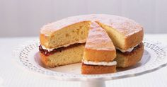 This easy Victoria sponge is a classic Victoria sponge cake recipe to master. The soft vanilla-infused sponge sandwiched together with a light buttercream and jam filling is a favourite for parties, birthdays and afternoon tea.