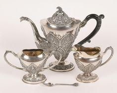 "Four piece tea set: Southeast Asian religious theme with deities and elephants.  Set includes a teapot, cream, sugar and spoon; F. W. Margrett & Co, Bangkok.  Teapot: 8 3/4""H."