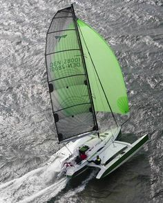 Dragonfly 28 trimaran with spinnaker