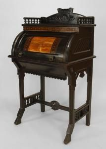 American Victorian Aesthetic Movement Ebonized Roll Top Lady's Desk with Gallery Top Upper Section & Stretcher Base with Lower Drawer and Inlaid & Incised Trim, Attributed to Herter Brothers.