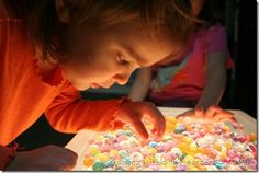 DIY Light Table for under 20 bucks! Kids are seriously fascinated by light & colors together - this is a great project.