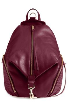 A campus-classic backpack goes glam in burgundy-hue leather and dangling tassels for some serious street-chic attitude.