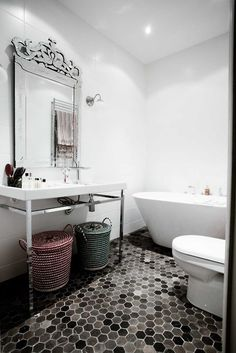 not really a fan of those baskets, but I LOVE that tile floor.