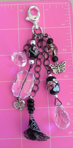 Purse charm, I would see this on my purse. I will need to decide on which purse. have so many purses.  I am a pursefashionita. LOL