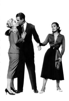 VERTIGO - Voted Best Film,  Period (British Film Institute); James Stewart is torn between two beautiful women-Kim Novak & Kim Novak-Directed by Alfred Hitchcock - Paramount - Publicity Still.