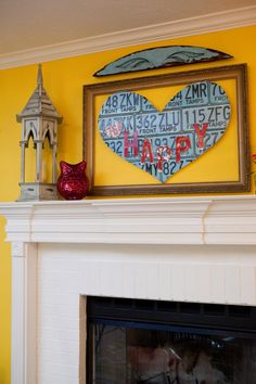 """Fashioned from old license plates, a sign saying """"Happy"""" brings that emotion to an already-cheerful yellow space."""