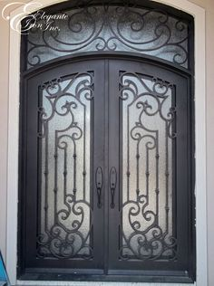 Custom wrought iron door with eyebrow arch transom.