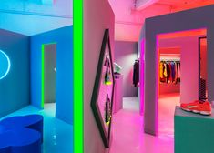 Robert Storey Studio uses lurid colours to light Nike pop-up shop.