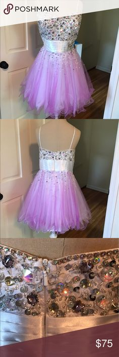 Hannah S Homecoming Dress White /Purple Originally size 16 taken in to a 12-14. Straps can be removed. Sweetheart neckline and tulle bottom. Satin top with beautiful jewels and embellishments. Worn once and in perfect condition! *PRICE IS VERY NEGOTIABLE!* Sherri Hill Dresses Prom