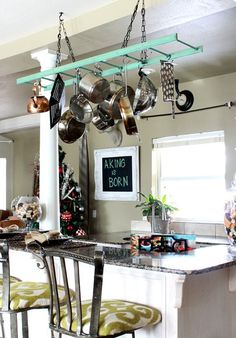 recycle and paint an old ladder to hang kitchen pots/pans