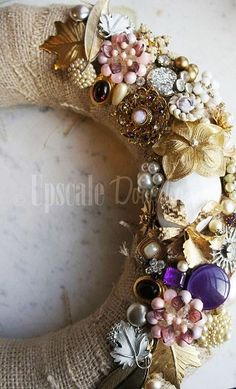 vintage jewelery wreath.  Great idea for displaying jewelry you don't wear anymore but can't part with.