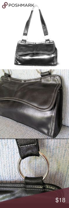 "Wilsons leather black leather handbag purse High quality black leather handbag in very good condition. White top stitching and silver accents. About 14"" long x 10"" high, give or take. Nice everyday size. Wilsons Leather Bags"