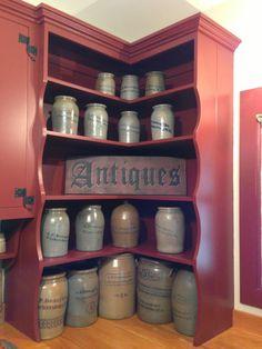 Corner Cupboard...filled with old salt glazed crocks.
