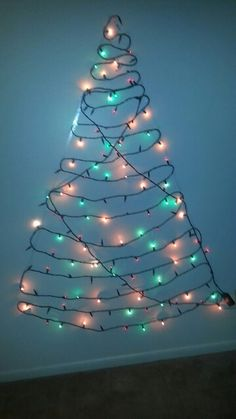 Easy diy christmas tree using command clear mini hooks and utensil make your own christmas tree with christmas lights dbl sided tape n a wall on a budget publicscrutiny Image collections