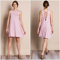 Lace Up Back Tank Dress Tank dress with lace up back detail. Available in pink and black. This listing is for the PINK. Brand new. True to size. This is an ACTUAL PIC of the dress - all photography done by me. Please do not use pictures without permission. NO TRADES DON'T ASK. Bare Anthology Dresses Mini