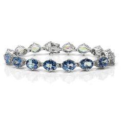 """Armbånd i 925 Sterling sølv dekorert med 16 stk blå topas. Total lengde: Ca 16,5 cm (6,5""""). Total vekt: 14,0 g. #smykke #armbånd #topas #925sterling #sølvsmykke #sølvarmbånd #zendesign Pandora Charms, Zen, Sapphire, Charmed, Bracelets, Rings, Jewelry, Design, Jewlery"""
