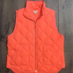J. Crew fluorescent orange puffer vest Gorgeous vest bought this last fall, warn this a couple times with a black lulu jacket under it does have some black marks that rubbed off on the armpit area. fits a true 12-16 J. Crew Jackets & Coats Vests