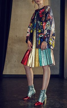 This **Romance Was Born** Rainbow pleat skirt features a rainbow colorblock design with a high rise a-line silhouette.
