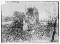 A man, women and a child sort through the rubble of a Polish home destroyed during World War I. Photograph taken ca. October 18, 1915.