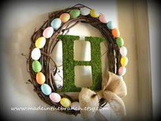 Custom Easter Wreath with Moss Covered Monogram and Coordinating Easter Egg Design. $45.00, via Etsy.