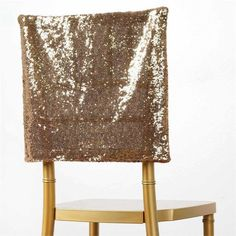 Premium Gold Sequin Chair Cap for Wedding Party Event Decoration | A Duchess is a lady whom stands a head above the rest. She is known for her leadership, charm and peerless sophistication. Every lady wants to be her because everything she does is both elegant and filled with grandeur.  And when the Duchess puts out an invite, she is sure to make her feast / celebration / announcement truly a feat of imagination. She transforms a plain chair with her Luxury Sequin Chair Caps into a chair fit…