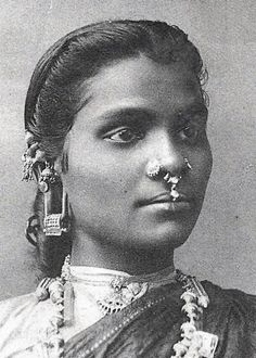 Ceylon (now Sri Lanka) | Tamil woman with nose piercing and interesting earrings | Taken from a postcard image published by Plâté & Co. ca. 1906-1910