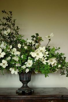 Sometimes a large, flowing arrangement of a single flower type with greens can make the grandest statement.