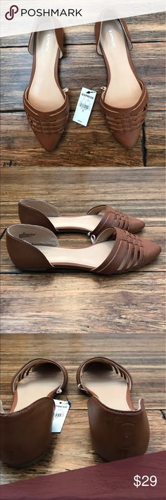 Express Tan Pointed Toe Flats Rich brown pointed toe Express flats. NWT. Small hole in heel of eight shoe from tags as pictured. Small scuffs on soles as pictured. Express Shoes Flats & Loafers